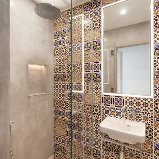 Medium sized mediterranean shower room in London with an alcove shower, multi-coloured tiles, grey walls, a vessel sink, a hinged door, flat-panel cabinets, brown cabinets, a built-in bath, a one-piece toilet, glass sheet walls, light hardwood flooring, wooden worktops and brown floors.