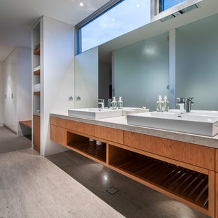 Inspiration for a contemporary 3/4 travertine floor walk-in shower remodel in Perth with a vessel sink, flat-panel cabinets, medium tone wood cabinets, white walls and engineered quartz countertops