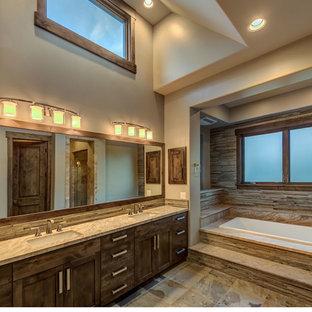 Идея дизайна: большая главная ванная комната в классическом стиле с фасадами с утопленной филенкой, коричневыми фасадами, накладной ванной, душем в нише, раздельным унитазом, бежевой плиткой, плиткой из сланца, бежевыми стенами, полом из сланца, врезной раковиной, столешницей из плитки, коричневым полом, душем с распашными дверями и бежевой столешницей
