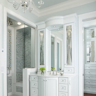 Alcove shower - traditional master gray tile alcove shower idea in Detroit with white cabinets, beaded inset cabinets, blue walls, an undermount sink and solid surface countertops