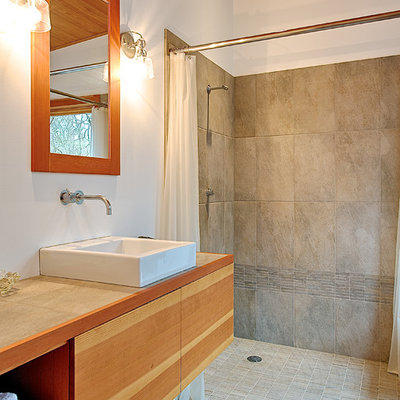 Inspiration for a small contemporary master gray tile and ceramic tile ceramic tile and gray floor bathroom remodel in Seattle with a vessel sink, flat-panel cabinets, light wood cabinets, white walls, tile countertops and gray countertops