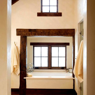 Large mountain style master porcelain floor bathroom photo in Other with beige walls