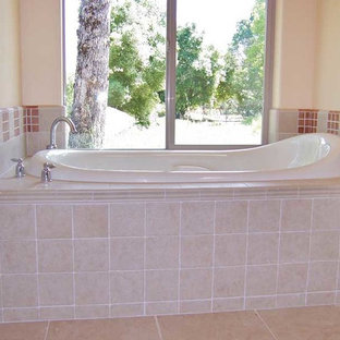 Mid-sized elegant master multicolored tile and ceramic tile ceramic floor drop-in bathtub photo in Other with flat-panel cabinets, white cabinets and tile countertops