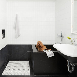 Inspiration for a contemporary black tile, black and white tile and white tile multicolored floor bathroom remodel in New York with multicolored walls and a wall-mount sink