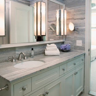 Inspiration for a large transitional master gray tile bathroom remodel in New York with an undermount sink, recessed-panel cabinets and white cabinets