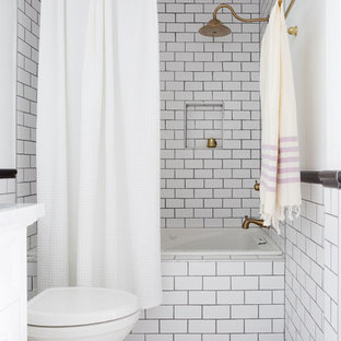 Example of a classic black and white tile and subway tile bathroom design in Orange County with white walls