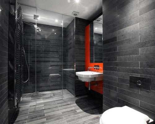 bathroom design ideas renovations photos with grey tiles and orange walls
