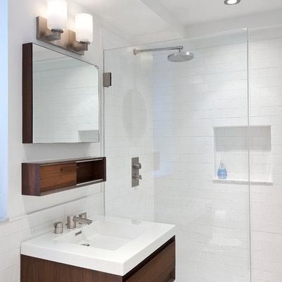 Inspiration for a small modern master white tile and subway tile marble floor and gray floor bathroom remodel in New York with an integrated sink, flat-panel cabinets, dark wood cabinets, solid surface countertops and white walls