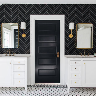 This is an example of a traditional bathroom in Grand Rapids with beaded cabinets, white cabinets, black tiles, grey walls, mosaic tile flooring, a submerged sink, marble worktops and multi-coloured floors.
