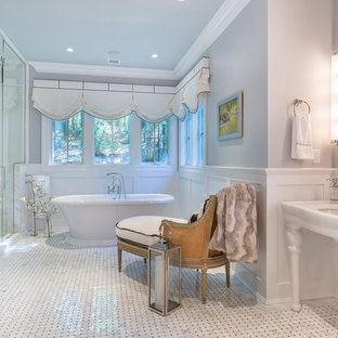Inspiration for a timeless white tile mosaic tile floor bathroom remodel in New York with a console sink and gray walls