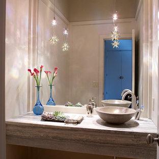 ニューヨークの小さいコンテンポラリースタイルのおしゃれなバスルーム (浴槽なし) (家具調キャビネット、一体型トイレ、白い壁、竹フローリング、ベッセル式洗面器、木製洗面台) の写真