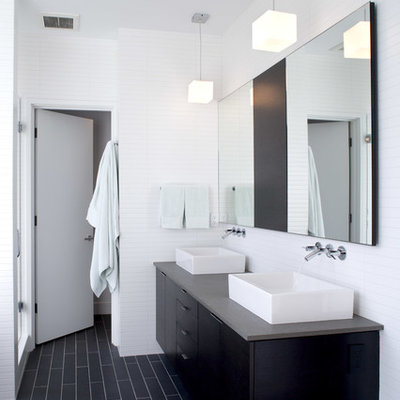 Inspiration for a modern black floor bathroom remodel in Seattle with a vessel sink