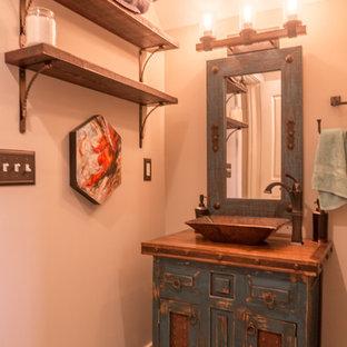Foto di una stanza da bagno con doccia american style con ante con riquadro incassato, ante in legno bruno, doccia alcova, piastrelle multicolore, piastrelle in ceramica, pavimento con piastrelle in ceramica, lavabo a bacinella e top in legno