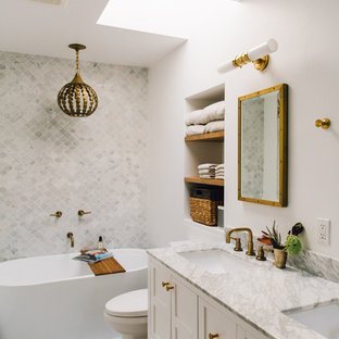 Freestanding bathtub - scandinavian 3/4 gray floor freestanding bathtub idea in Sacramento with shaker cabinets, white cabinets, a two-piece toilet, white walls, an undermount sink and gray countertops