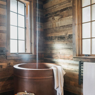 Japanese bathtub - large rustic master black floor japanese bathtub idea in Other with brown walls