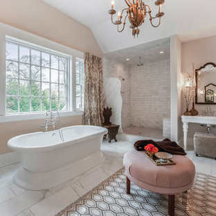 Large transitional master bathroom in New York with a freestanding tub, an alcove shower, white tile, beige walls, marble floors, a pedestal sink, an open shower and marble.