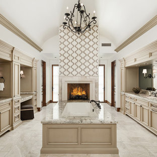 Inspiration for a huge mediterranean master marble floor and beige floor bathroom remodel in Phoenix with recessed-panel cabinets, beige cabinets, an undermount tub, white walls, an undermount sink and granite countertops