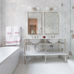 Bathroom - mid-sized transitional master white tile and ceramic tile ceramic tile bathroom idea in New York with marble countertops, a console sink, white walls and a hinged shower door