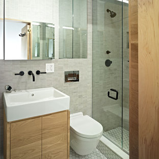 This is an example of a contemporary bathroom in New York with an integrated sink.