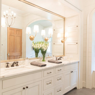 Large elegant master porcelain tile, gray floor, double-sink, coffered ceiling and shiplap wall bathroom photo in New Orleans with recessed-panel cabinets, white cabinets, white walls, an undermount sink, gray countertops and a built-in vanity