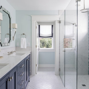 Wet room - large craftsman master multicolored tile and glass sheet porcelain floor and gray floor wet room idea in Portland with shaker cabinets, blue cabinets, a one-piece toilet, green walls, an undermount sink, engineered quartz countertops and a hinged shower door