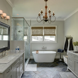 Country master gray floor bathroom photo in Atlanta with shaker cabinets, gray cabinets, gray walls, an undermount sink, a hinged shower door and gray countertops