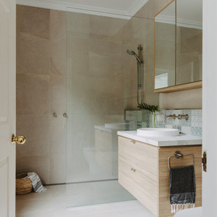 Inspiration for a mid-sized contemporary 3/4 bathroom in Hobart with flat-panel cabinets, light wood cabinets, a curbless shower, beige tile, a drop-in sink, beige floor, an open shower, white benchtops, a single vanity and a floating vanity.