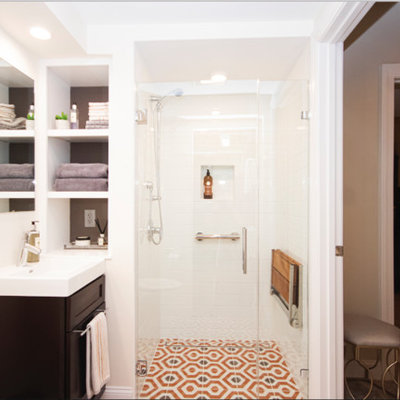 Inspiration for a small eclectic master white tile and subway tile mosaic tile floor and orange floor walk-in shower remodel in Providence with recessed-panel cabinets, dark wood cabinets, a two-piece toilet, beige walls, a drop-in sink and a hinged shower door