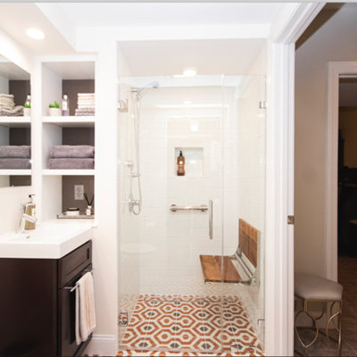 Example of a small eclectic master white tile and subway tile mosaic tile floor and orange floor walk-in shower design in Providence with recessed-panel cabinets, dark wood cabinets, a two-piece toilet, beige walls, a drop-in sink and a hinged shower door