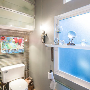 Example of an eclectic bathroom design in San Francisco with a two-piece toilet and gray walls