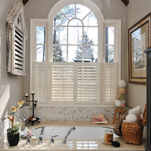 Inspiration for a shabby-chic style beige tile bathroom remodel in Atlanta with an undermount tub