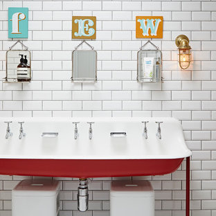 Eclectic family bathroom in London with a trough sink, white tiles and metro tiles.