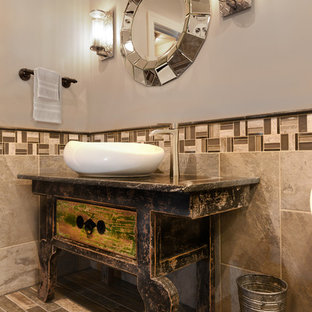 Bathroom - mid-sized eclectic beige tile and travertine tile porcelain floor and gray floor bathroom idea in Baltimore with furniture-like cabinets, gray walls, a vessel sink, marble countertops and an urinal