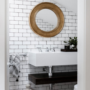 Inspiration for a mid-sized eclectic bathroom in Sydney with white walls and a wall-mount sink.
