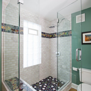 Mid-sized eclectic 3/4 multicolored tile and ceramic tile light wood floor and brown floor corner shower photo in Minneapolis with recessed-panel cabinets, light wood cabinets, wood countertops, green walls, a two-piece toilet and a hinged shower door