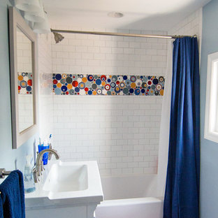 Inspiration for a small eclectic kids' multicolored tile, white tile and mosaic tile ceramic floor bathroom remodel in Minneapolis with recessed-panel cabinets, white cabinets, a one-piece toilet, blue walls, an integrated sink and quartz countertops