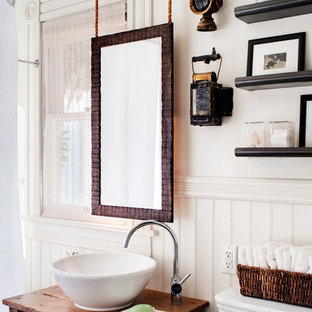 Mid-sized eclectic master dark wood floor tub/shower combo photo in San Francisco with a vessel sink, open cabinets, a one-piece toilet, white walls, wood countertops, dark wood cabinets and brown countertops