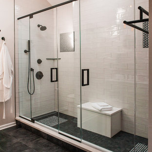 Inspiration for a mid-sized eclectic master white tile and ceramic tile porcelain floor and black floor wet room remodel in Chicago with shaker cabinets, green cabinets, white walls, quartzite countertops and a hinged shower door