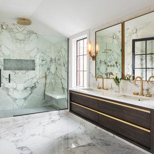 Trendy master multicolored floor alcove shower photo in New York with flat-panel cabinets, brown cabinets, multicolored walls, an undermount sink, a hinged shower door and white countertops