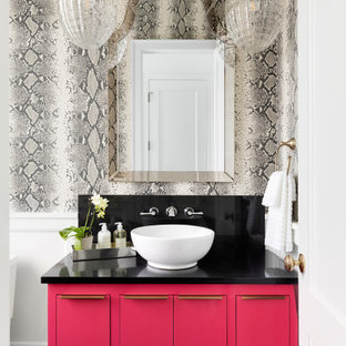 Example of a mid-sized trendy single-sink and wallpaper bathroom design in Minneapolis with flat-panel cabinets, red cabinets, gray walls, a vessel sink, black countertops and a floating vanity