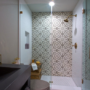 Inspiration for a small eclectic 3/4 gray tile and cement tile concrete floor alcove shower remodel in San Francisco with gray walls, open cabinets, a two-piece toilet and concrete countertops