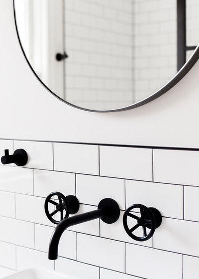 Industrial Bathroom by Schmauder Group