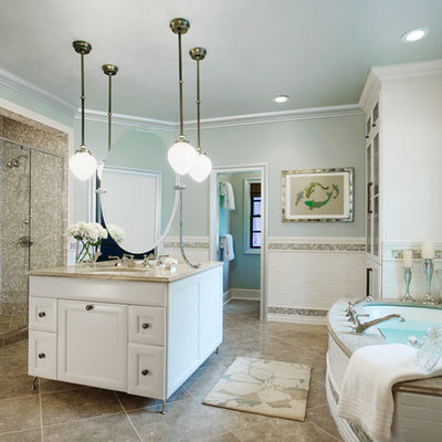 Example of an eclectic master multicolored tile and subway tile marble floor and beige floor bathroom design in Other with glass-front cabinets, white cabinets, blue walls, an undermount sink, granite countertops and a hinged shower door