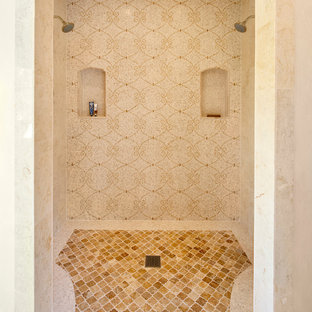 Photo of a mediterranean bathroom in Santa Barbara with an alcove shower, beige tiles and beige walls.