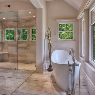 Bathroom - large eclectic master stone slab and beige tile porcelain floor bathroom idea in Other with flat-panel cabinets, medium tone wood cabinets, an urinal, beige walls, a vessel sink and granite countertops