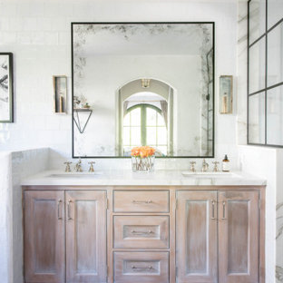 Inspiration for a mediterranean white tile blue floor bathroom remodel in Los Angeles with beaded inset cabinets, light wood cabinets, an undermount sink, white countertops and a built-in vanity