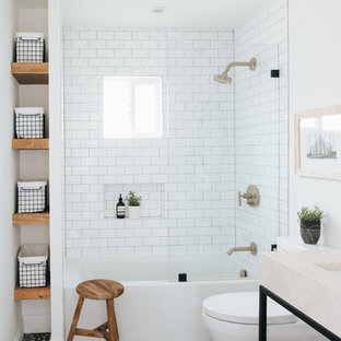 Medium sized contemporary family bathroom in Other with open cabinets, an alcove bath, a shower/bath combination, a two-piece toilet, white tiles, porcelain tiles, white walls, cement flooring, marble worktops, multi-coloured floors, an open shower, beige worktops and a submerged sink.