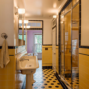 Large elegant master white tile and ceramic tile ceramic tile and yellow floor bathroom photo in New York with yellow walls, a pedestal sink and a hinged shower door
