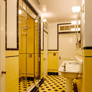 Design ideas for a large traditional master bathroom in New York with a claw-foot tub, an open shower, white tile, ceramic tile, yellow walls, ceramic floors, a pedestal sink, yellow floor and a hinged shower door.