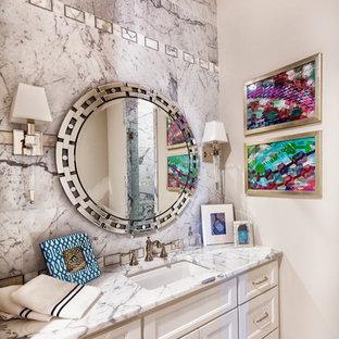 Foto de cuarto de baño con ducha, ecléctico, de tamaño medio, con armarios con paneles empotrados, puertas de armario blancas, ducha empotrada, baldosas y/o azulejos blancos, baldosas y/o azulejos de mármol, paredes blancas, suelo con mosaicos de baldosas, lavabo bajoencimera y encimera de mármol
